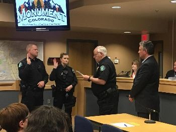 Officers Rachel Braaten & Joshua Marks swearing in by Chief Shirk & Mike Foreman