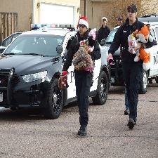 Police officers carrying presents